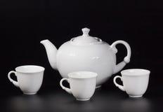 Tasse de thé sur un fond noir Photographie stock