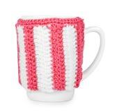 Tasse de thé tricotée d'isolement sur le fond blanc Photographie stock libre de droits