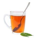 Tasse de thé avec la cuillère Photos stock