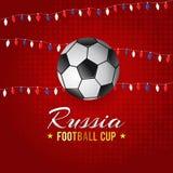 Tasse du football de la Russie avec le fond rouge Photographie stock
