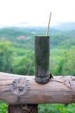 Tasse en bambou avec la cuillère en bambou Photos libres de droits
