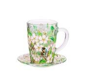 Tasse en verre avec l'ornement floral peint Photos stock