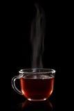 Tasse en verre de thé avec de la vapeur image stock