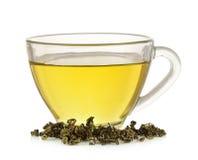 Tasse en verre de thé vert d'isolement sur le fond blanc Images libres de droits