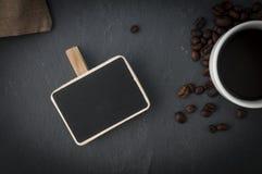 Tasse et ardoise de café Photos libres de droits