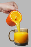Tasse et cuvette oranges Image stock