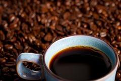 Tasse et haricots de café Image libre de droits