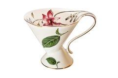 Tasse et soucoupe antique de thé de la Chine avec des feuilles et des fleurs sensibles image libre de droits