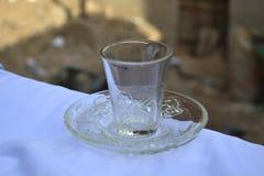 Tasse et soucoupe de verrerie Images stock