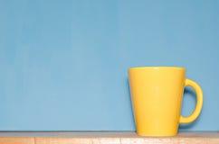 Tasse jaune Photo stock