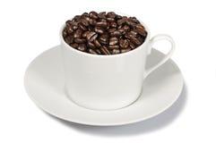 Tasse Kaffee-Bohnen lizenzfreies stockfoto
