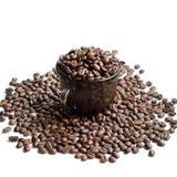 Tasse Kaffee-Bohnen - Foto auf Lager Stockfotos