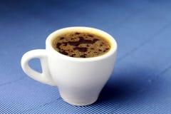 Tasse Kaffee mit Hintergrund Lizenzfreies Stockbild