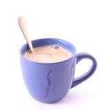 Tasse Kaffee mit Milch Stockfotografie