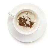 Tasse Kaffee mit Schaum und Pulver in Form Kanadas (serie Stockbilder