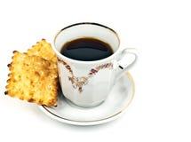 Tasse Kaffee und Biskuite Stockbild