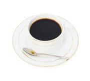 Tasse Kaffee und Löffel Stockbild