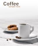 Tasse Kaffee und Plätzchen Stockfotos