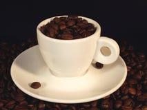 Tasse Kaffeebohnen Stockfotos