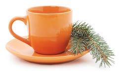 Tasse orange avec un arbre Images libres de droits