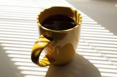 Tasse orange de thé Image libre de droits