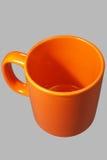 Tasse orange une Photos stock