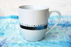 Tasse peinte à la main Photos stock