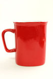 Tasse rouge de café sur le fond blanc Photo stock