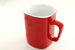 Tasse rouge de café sur le fond blanc Photographie stock