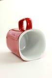 Tasse rouge de café sur le fond blanc Image stock