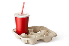 Tasse rouge de carton dans le support de tasse Photo stock