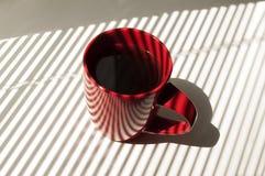 Tasse rouge de thé Photo stock