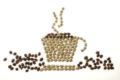 Tasse, soucoupe et vapeur de café, faites de haricots Images libres de droits