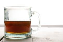 Tasse Tee hintergrundbeleuchtet Stockbilder