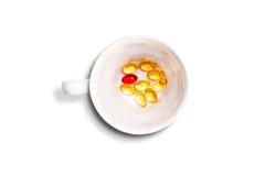 Tasse Tee mit Drogen in ihr Lizenzfreie Stockfotografie