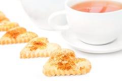 Tasse Tee mit Plätzchen Stockfoto