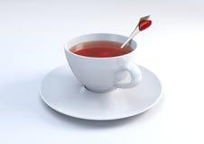 Tasse Tee mit reizendem Löffel Lizenzfreies Stockfoto