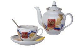 Tasse Tee mit Zitrone und Zucker, Teekanne, mit den Symbolen von Rus Stockbild