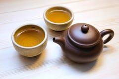 Tasse Tee und Teekanne Stockbilder