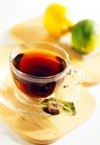 Tasse Tee und Zitronen Stockbild