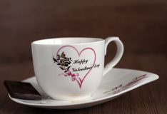 Tasse und Untertasse, Grüße glücklicher Valentinsgruß ` s Tag Stockbild
