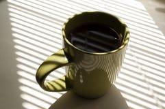 Tasse verte de thé Image libre de droits