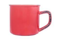 Tasse vide rouge d'émail Photographie stock