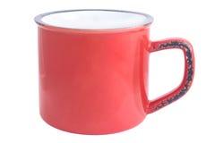 Tasse vide rouge d'émail sur le blanc Images stock
