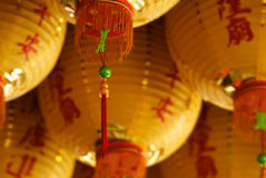 The tassel of chinese knot in yellow lantern Stock Photo