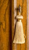 Tassel and Key. Photo of a tassel and key with nice wood background stock image