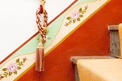 Tassel on red diagonal design Stock Photography
