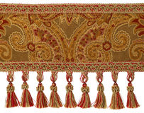 Tassels and Fabric Trim. Red and Gold Tassels with Trim on Fabric stock photography