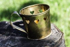 Tasses avec des formes de coeur Photos stock