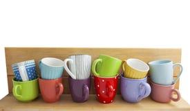 Tasses colorées dans une rangée Images libres de droits